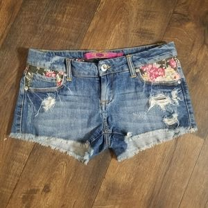 c pink distressed floral jeans shorts